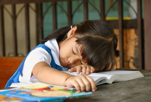 17_little_girl_sleeping_at_school
